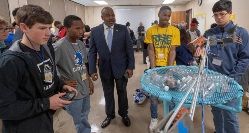 Students demonstrating robotics projects during competition
